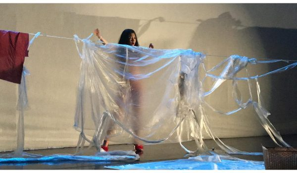 """Kayla Tange Performing In """"Meat Market: On The Cutting Board"""" At Highways Performance Space & Gallery, January 2019. Photo By Patrick Kennelly. Courtesy Of Highways Performance Space & Gallery."""