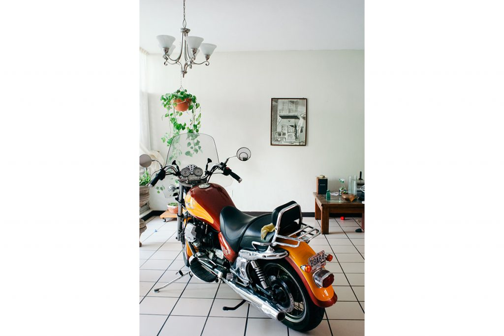 Motoguzzi motorcycle in the living room of the artist\'s ...