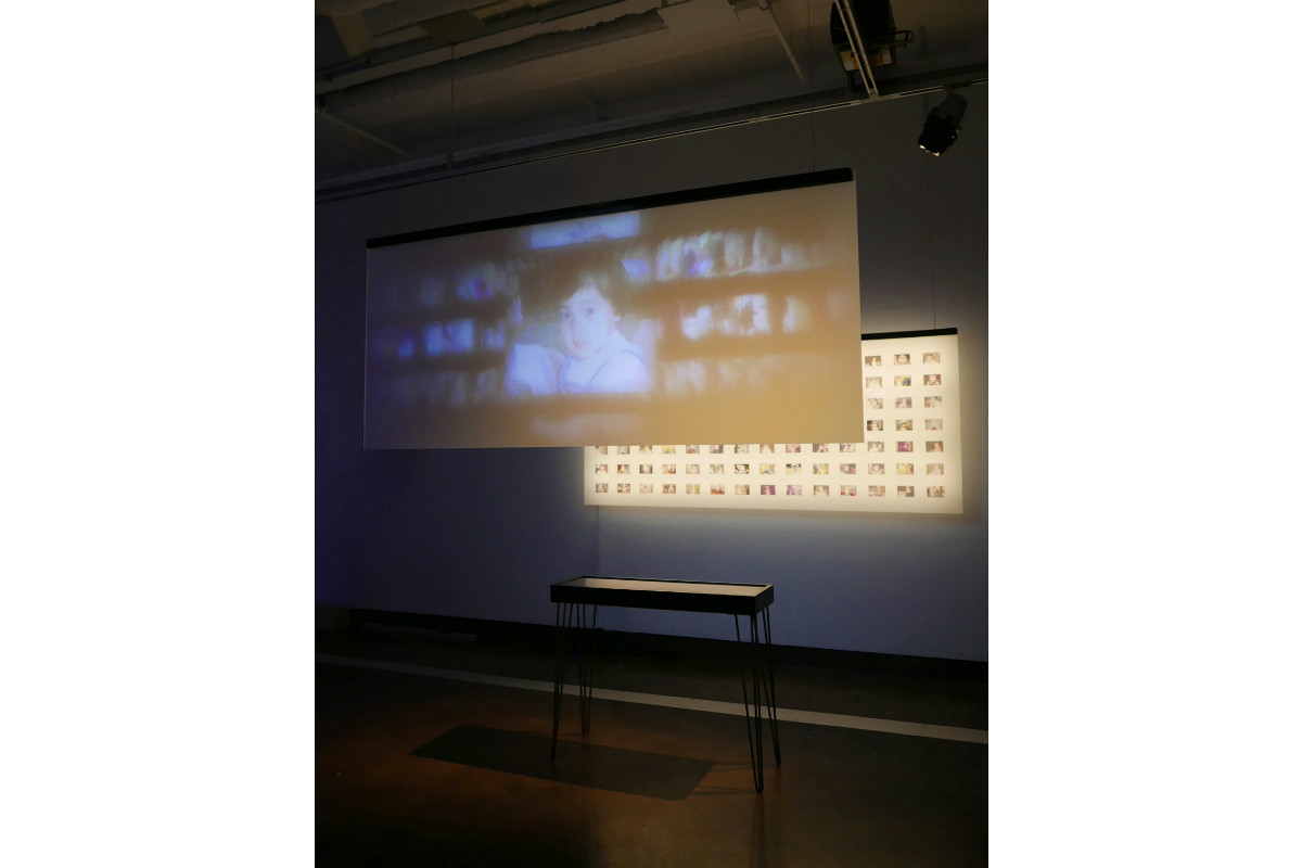 Poyen Wang, A Fabricated Personal Archive, 2017, Dimensions Vary, Mixed Media Installation: Digital Video Projection (color, Sound, 4 Minutes/loop), Plastic Glass Sheets, Led Lights, Transparent Films, Customized Vitrine, 3D Printed Objects. Photo By Poyen Wang. Courtesy Of Poyen Wang.