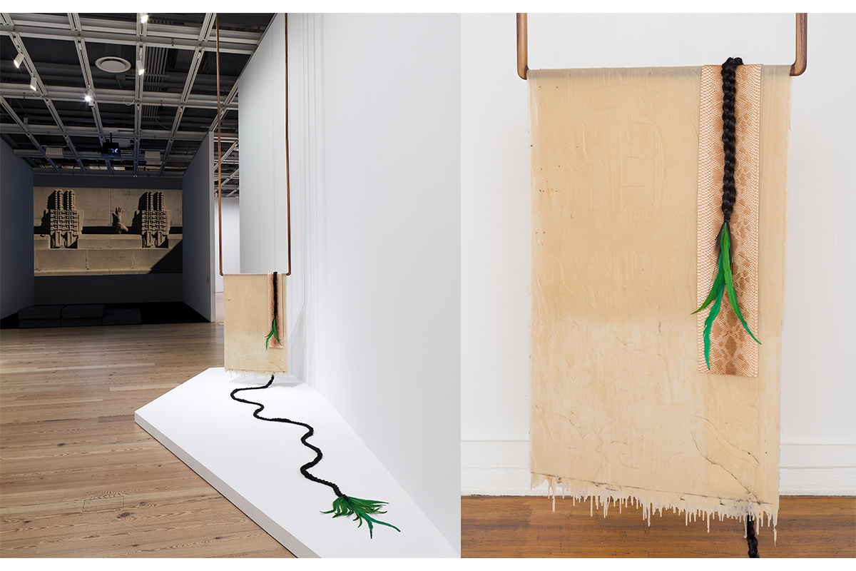 Clarissa Tossin, Yaxchilán Lintel 25 (feathered serpent), 2017. Dimensions variable, Silicone, walnut, faux serpent skin, synthetic hair, quetzal faux feather (dyed rooster feather), Installation view at Whitney Museum of American Art, New York