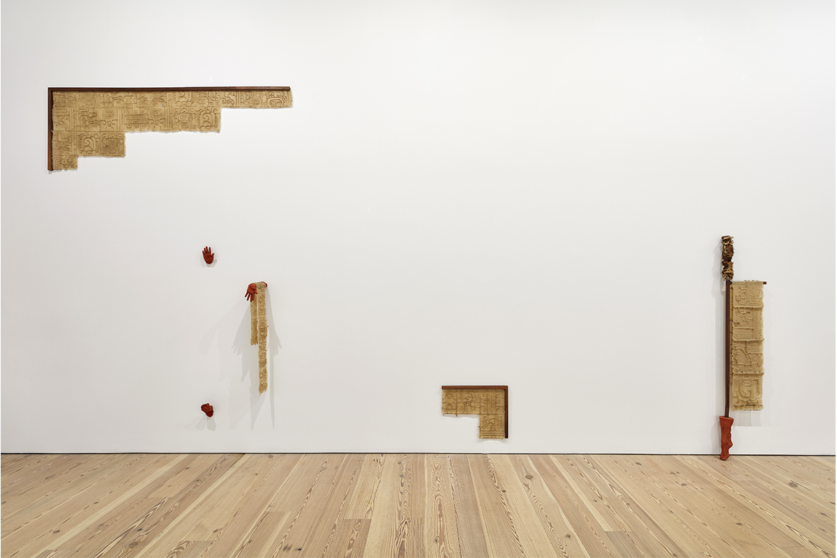 RIGHT: Clarissa Tossin, A cycle of time we don't understand (reversed, invented, and rearranged), 2017. Dimensions variable, Silicone, walnut, faux terracotta (dyed plaster), Installation view at Whitney Museum of Art. LEFT: Clarissa Tossin, xojowisaj ja (to make the building dance), 2017. 85 x 17 ½ x 6 inches, Silicone, walnut, jaguar faux fur, faux terracotta (dyed plaster), Installation view at Whitney Museum of Art, New York.