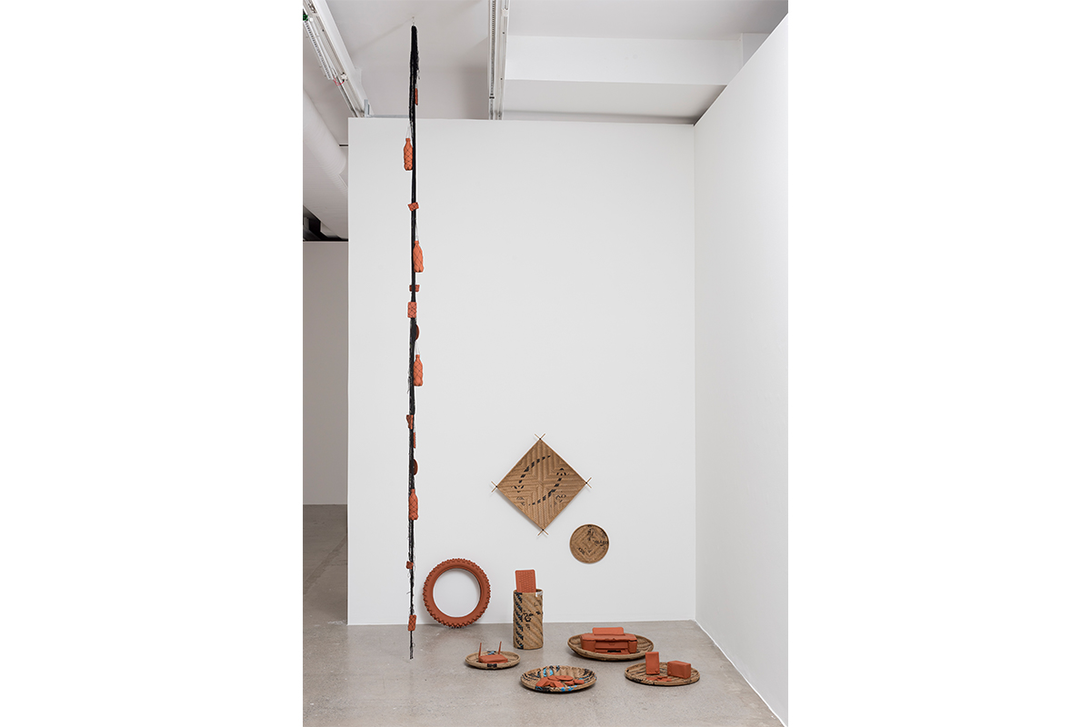Clarissa Tossin, Nova Gramática de Formas #1 (New Grammar of Forms #1), 2018. terra-cotta objects, fishnet, thread, and woven indigenous baskets made out of Amazon.com boxes, Installation view at Luisa Strina Gallery, São Paulo.
