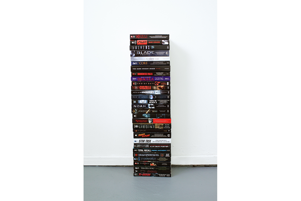 Anthony Discenza, Every Picture Tells a Story, 2015. 22 x 7 x 4.5 inches. Stack of film novelizations. Courtesy of the artist.