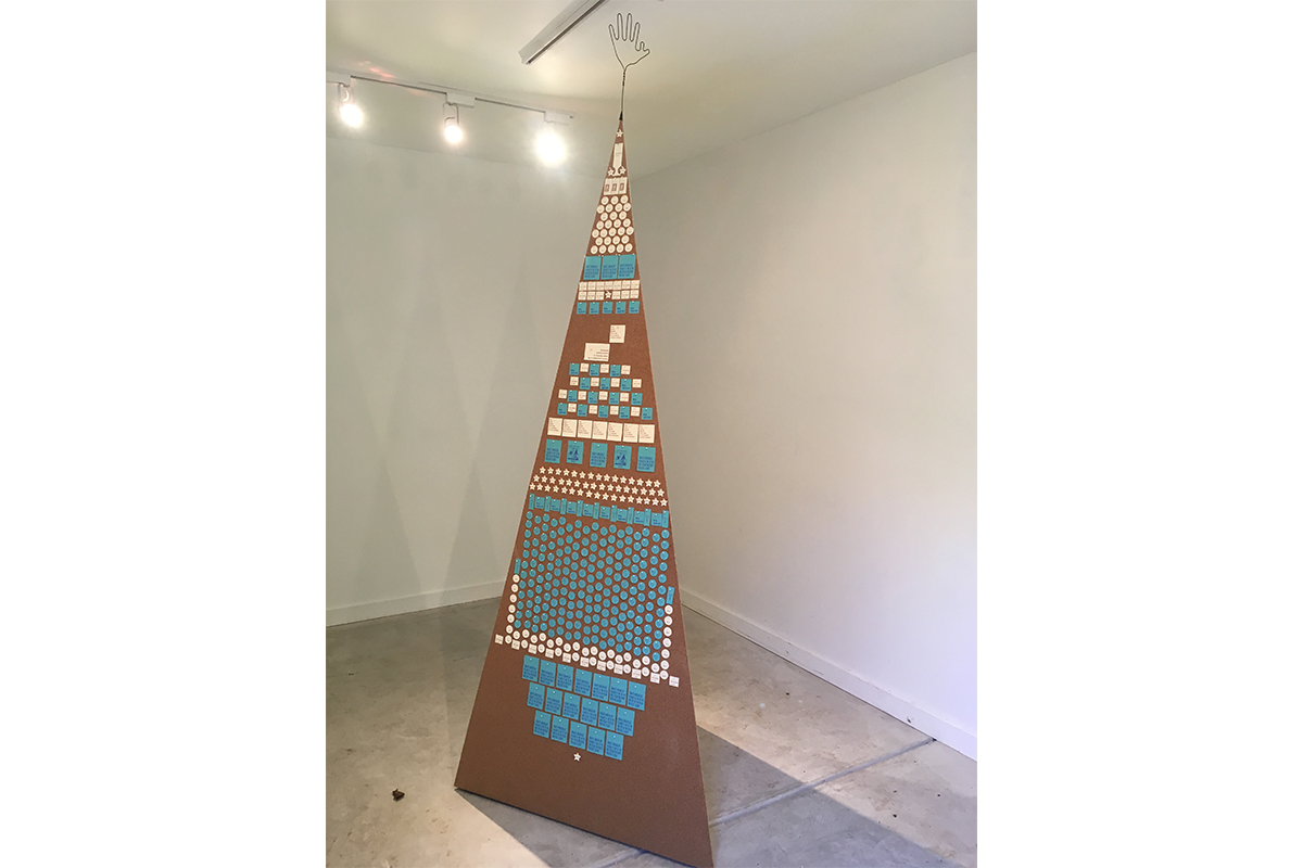 "Dan S. Wang, 99.9 WENO no-watt radio, 2017. Tetrahedral tower ""broadcasting"" within arm's length radius. All text printed from handset metal type. Courtesy of the artist."