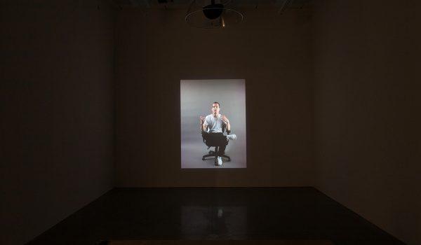 Damir Avdagic, Prevodenje (Translation), 2014. 16:13 Minutes. SD-video, Sound. Installation View. Photo By Paul Mpagi Sepuya.