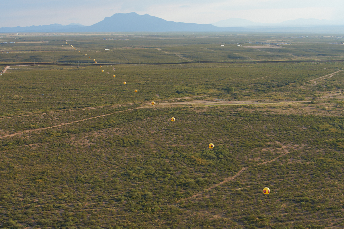 Postcommodity, Repellent Fence, 2015. Earth, cinder block, para-cord, pvc spheres, helium. Land art installation and community engagement. Installation view, US/Mexico Border, Douglas, Arizona / Agua Prieta, Sonora. Courtesy of the artist.