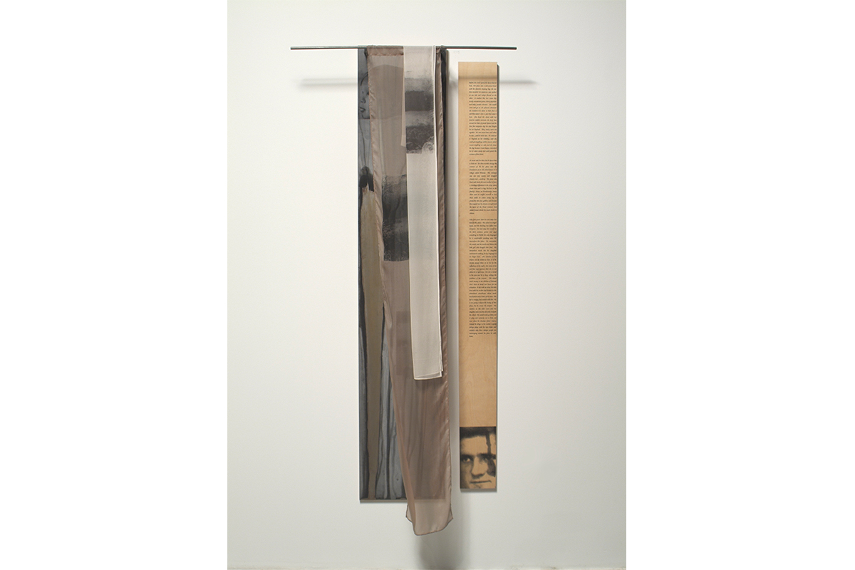 Rachel Grynberg, Hiding Place, 2003. Ink, silk, steel. 20 x 60 inches. Photo by Gene Ogami.