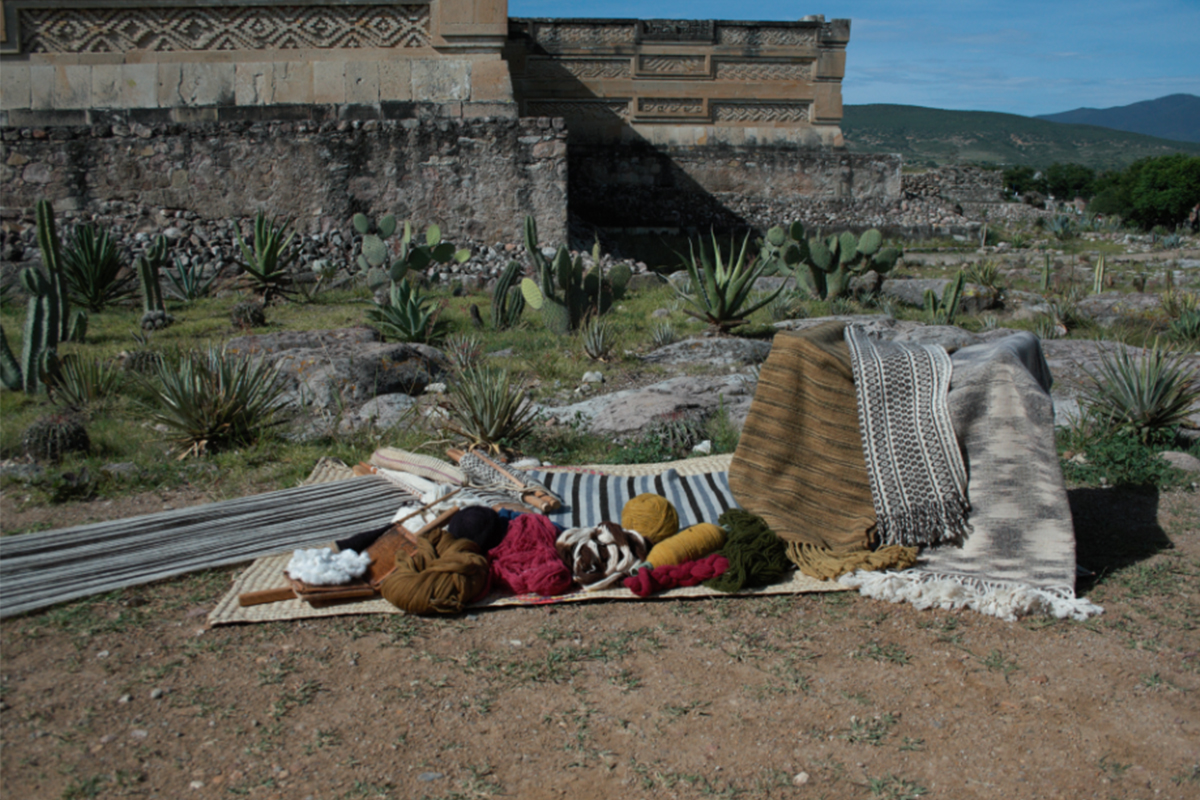 Arturo Hernández, photo of rebozos with natural dyes and unique designs, Mitla ruins, Oaxaca, Mexico. Courtesy of the artist.