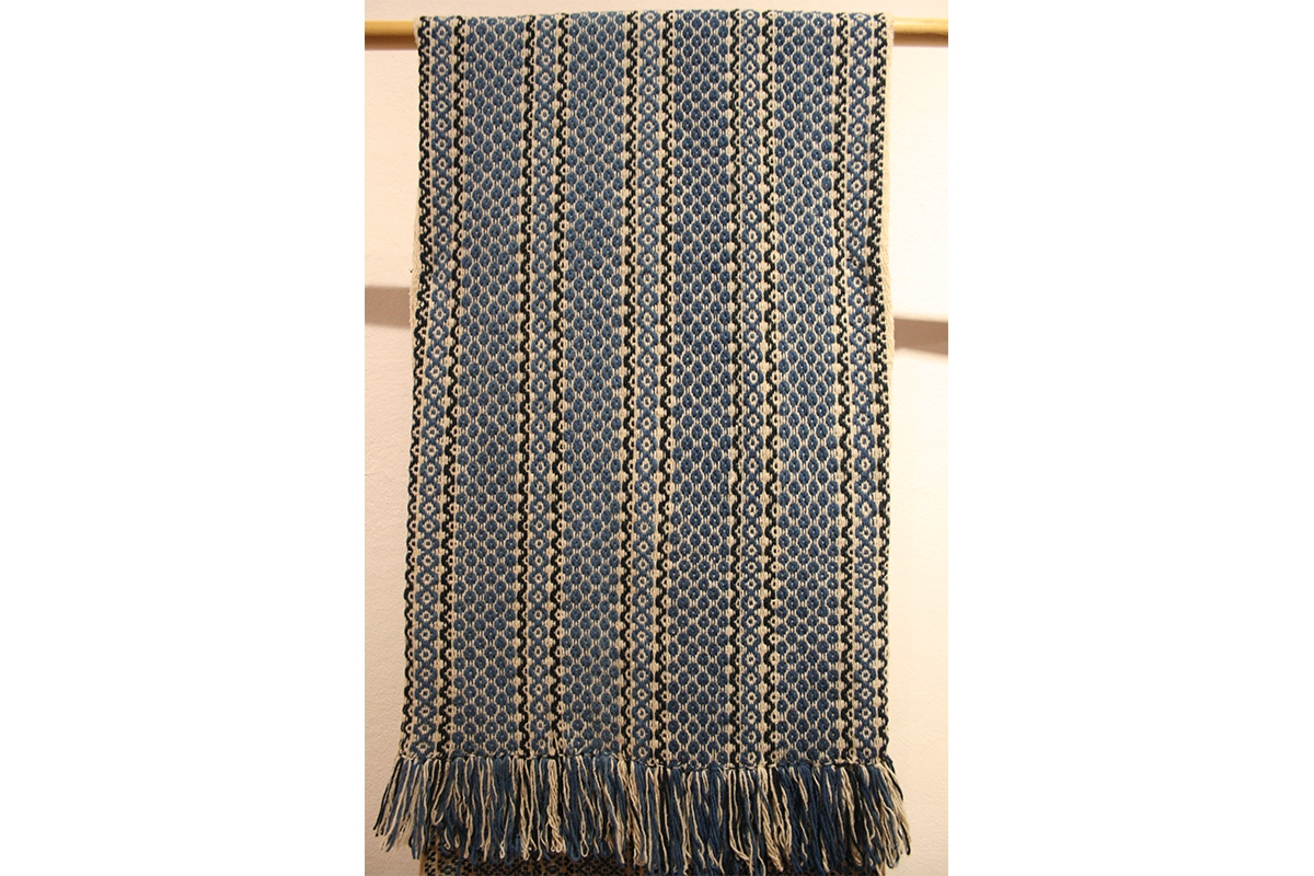 Arturo Hernández, photo of corn, cocoa and snake design textil, dyed in indigo, backstrap weaving. Courtesy of the artist.