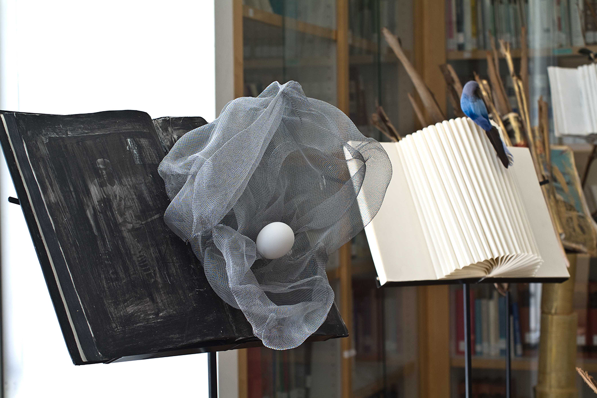 Luigia Gio Martelloni, Parole al Vento (conversation piece between Duchamp and Bach), 2011. Books, Metal net, egg, mix media on standing. Site specific installation. 54th international Art exhibition Venice Biennale. Photo by Gene Ogami. Courtesy of the artist.