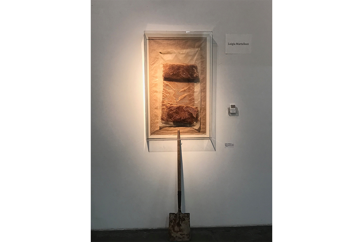 Luigia Gio Martelloni, Luigia Martelloni Back to the Source Silence, 2017. Paper, plexiglass, shovel. 40x30x5 inches. Element exhibition at the Loft at Liz's gallery. Photo by Gene Ogami. Courtesy of the artist.