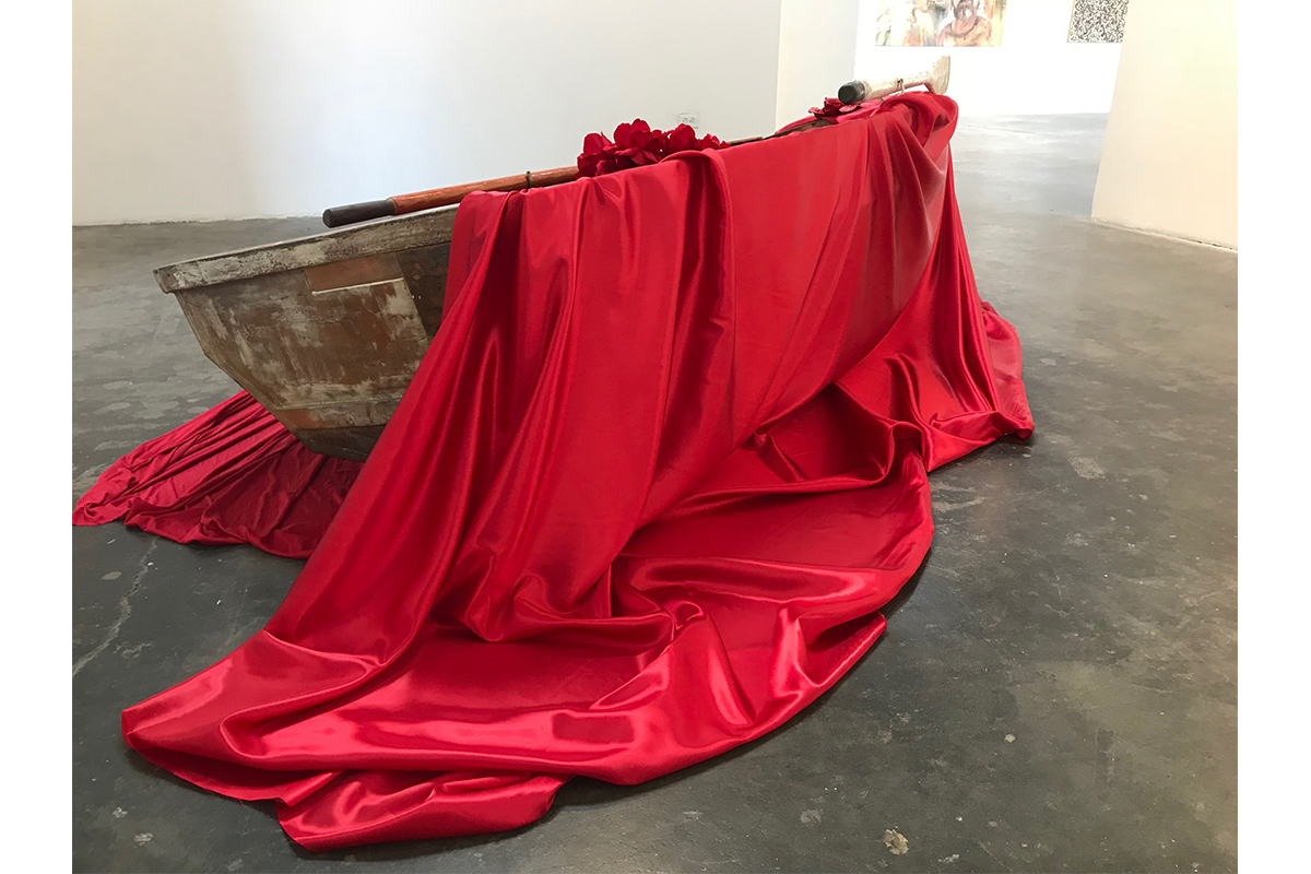 Luigia Gio Martelloni, Sea of Promises, 2018. Wooden boat, fabric, red roses. 8 x 4 ft. Arena 1 Gallery. Photo by Luigia Martelloni. Courtesy of the artist.