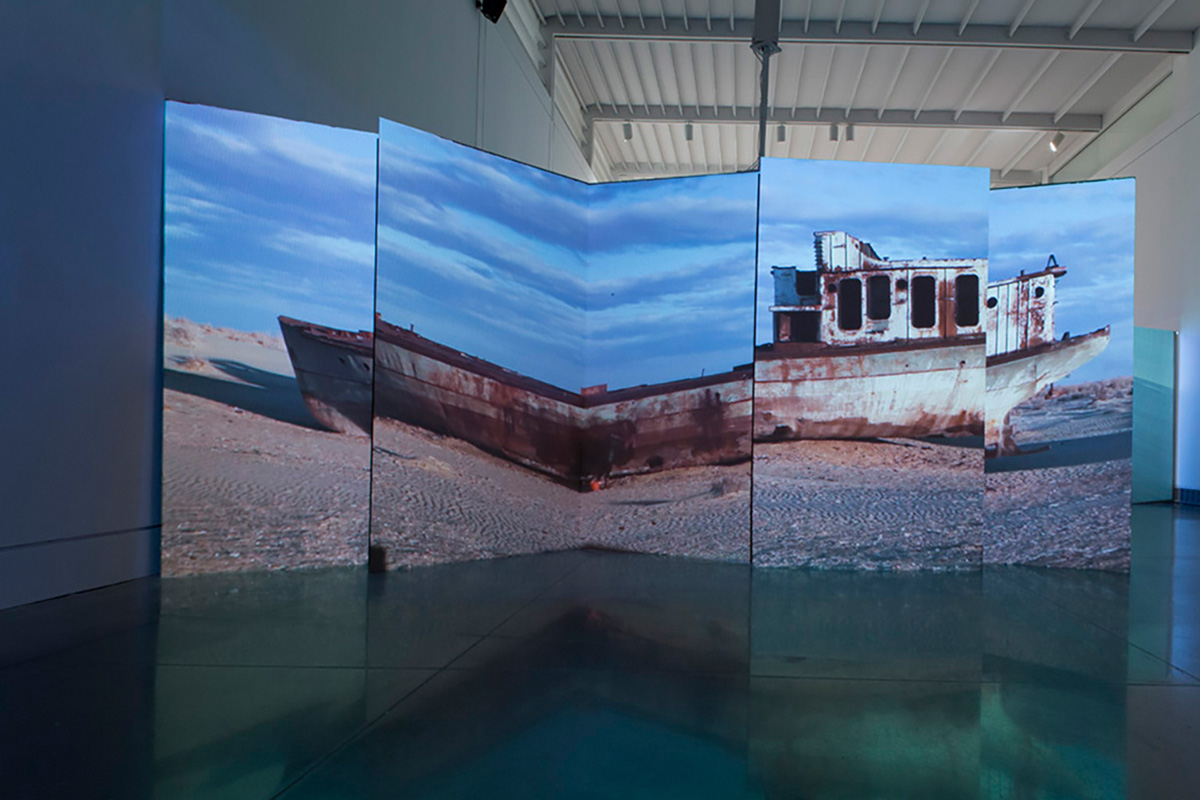 Patty Chang, Invocation for a Wandering Lake, Part 2, 2016. Video projection on cardboard bifold panels. Variable dimensions. Photo by Hai Zhang. Courtesy of the artist.