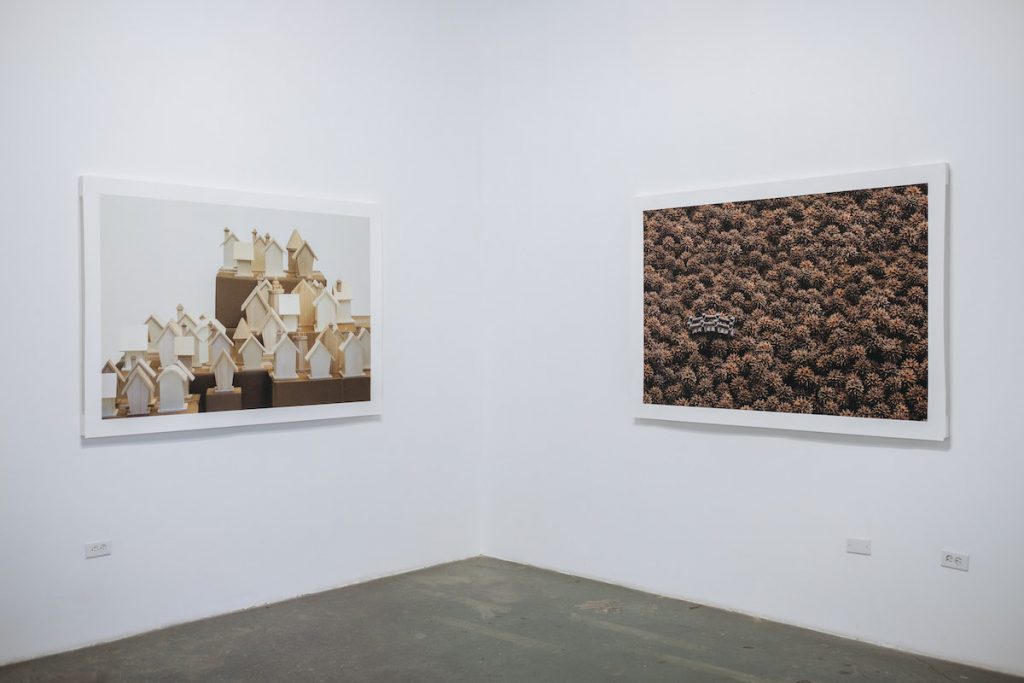 Luciana Abait, Off the Map I & II, Untitled (from the Displacement series), 2016. Archival photograph, 30 x 40 in, 40 x 60 in. Installation view. Photo credit: Kenji Barrett.