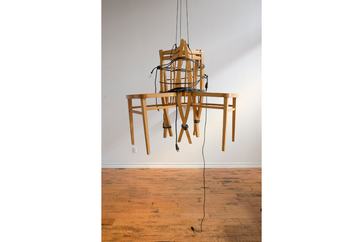 Melinda Smith Altshuler, Ascension Suspension Descent 1.0, 2019. Chairs, electrical wires and connections, victorian hook, and light suspended at 12' Photo by Gene Ogami. Courtesy of the artist.