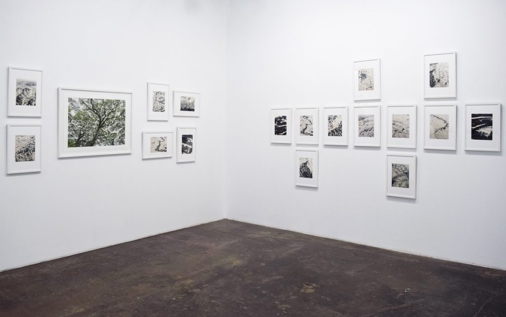 Pamela Simon-Jensen, Aerial Iowa Series & It Makes Me Wonder, 2020. Archival photographs, 11x8 in, 31x39 in. Installation view. Photo credit: Juan Silverio.