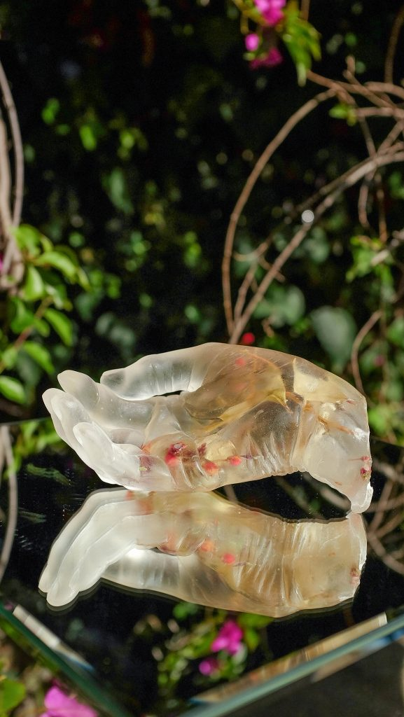 "Rachel Chu, Mother's Hand .03, 2020. Eucalyptus berries encased in epoxy resin. 6.5"" x 3.5"" x 3"". Courtesy of the artist."