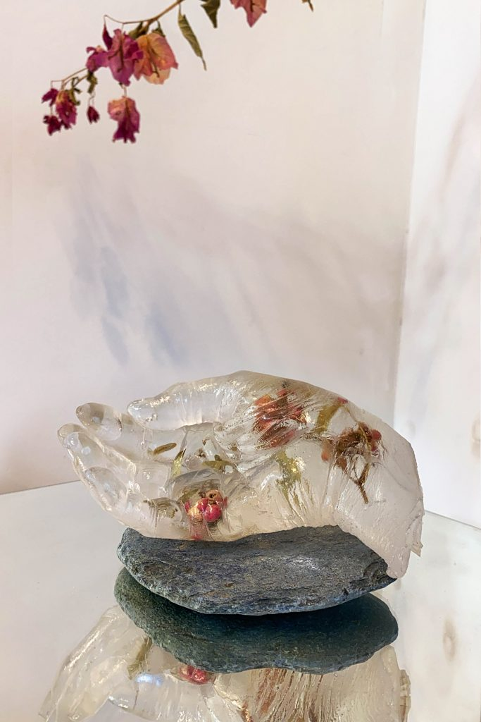 "Rachel Chu, Mother's Hand .01, 2020. Eucalyptus berries encased in epoxy resin. 6.5"" x 3.5"" x 3"". Courtesy of the artist."