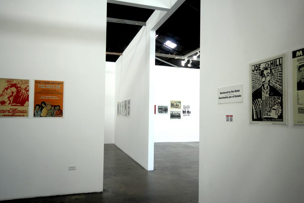Center for the Study of Political Graphics, To Protect & Serve? Five Decades of Posters Protesting Police Violence, 2020. Installation view. Airport Gallery, 18th Street Arts Center. Santa Monica, CA. Photo Credit: Frida Cano. Courtesy of 18th Street Arts Center and CSPG.