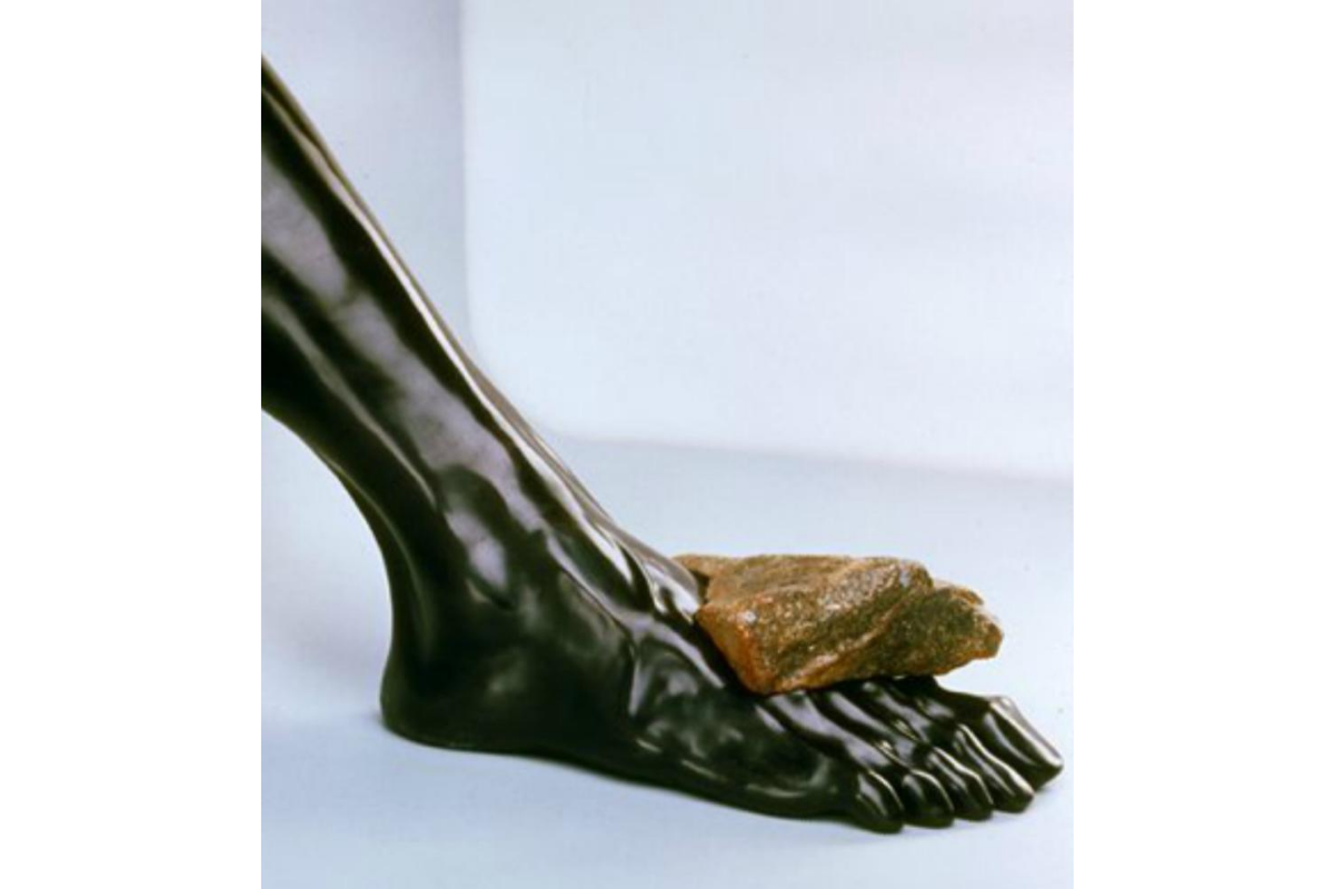 Rebecca Setareh, Crushed. 17 x 10 x 14 inches. Bronze and rock. Courtesy of the artist.