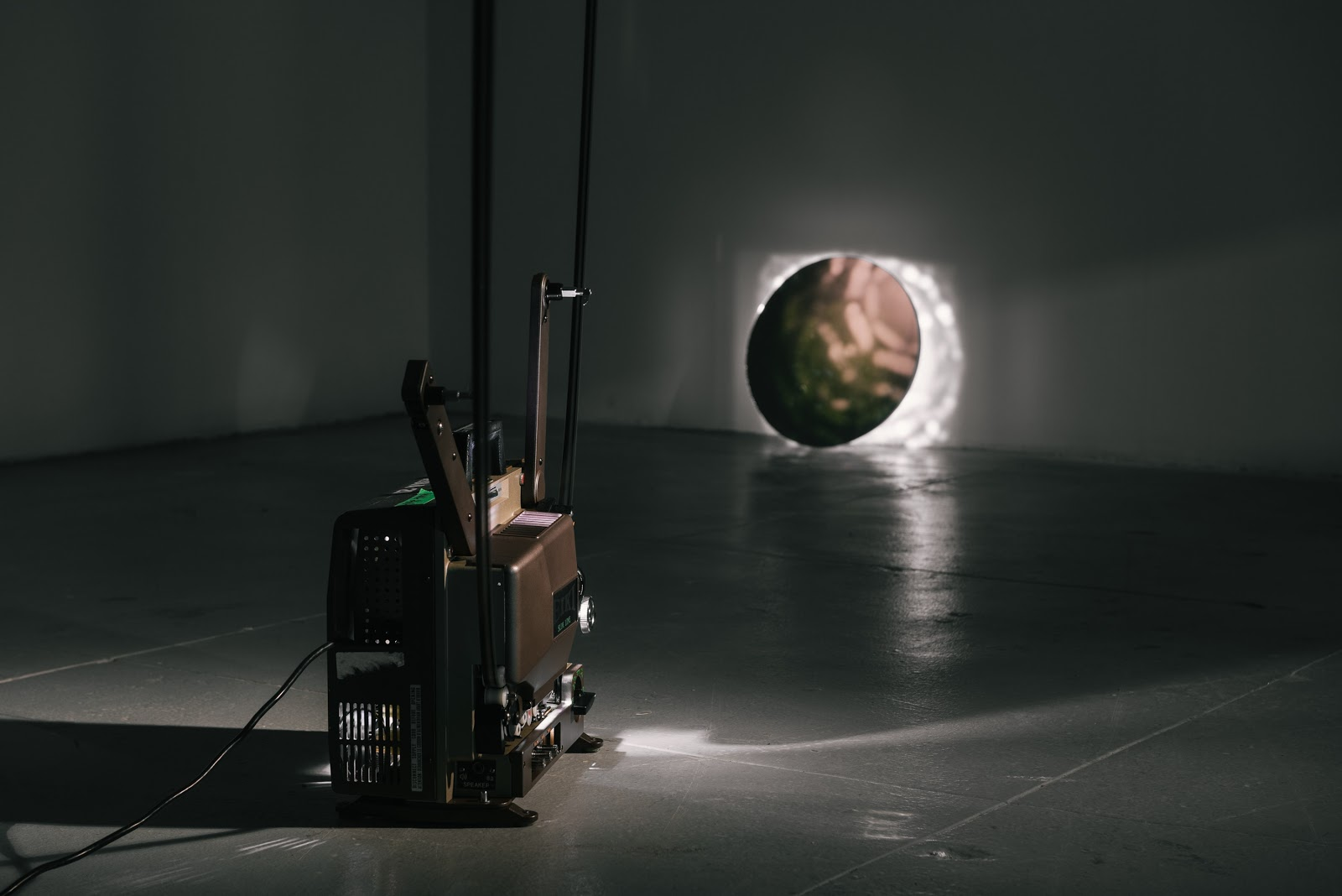 Nung-Hsin Hu, Eternal Return, 2019. Arctic Sunlight 16mm Film Loop, 16mm Analog Projector, A Round Mirror. Courtesy Of The Artist.