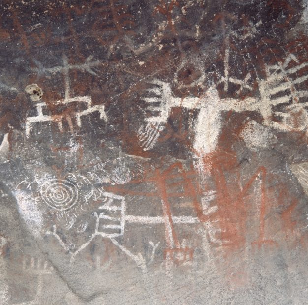 """The Cave of Munits: Located at the west end of the ridge where Castle Peak is located, this is the home of the doctor (shaman) Munits who willingly helps a captain (chief) kill his son in the deeply symbolic and cautionary myth of """"Rawi'jawi."""""""