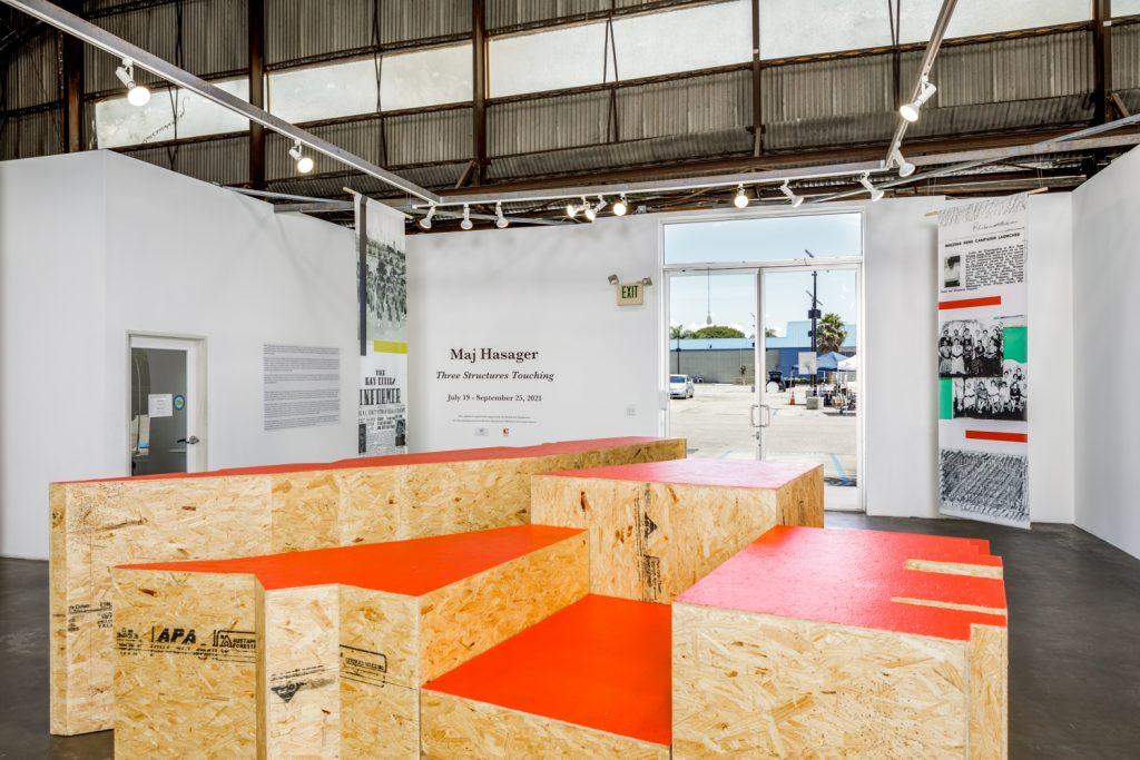 """Maj Hasager and the Quinn Research Center. """"Three Structures Touching,"""" 2021. Installation view at 18th Street Arts Center's Airport Campus Propeller Gallery. July 26 - September 25, 2021. Photo by Marc Walker."""